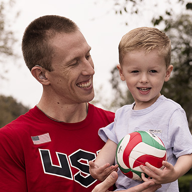 Oticon hearing aid testimonial David and son with volleyball-382x382